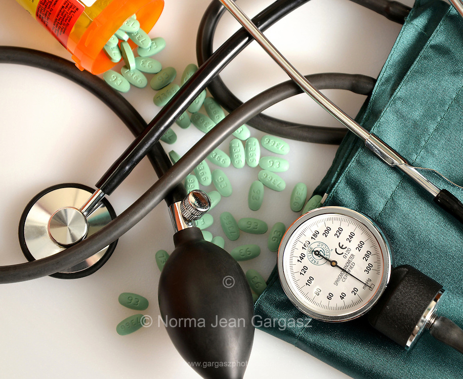 A blood pressure cuff, or sphygmomanometer, a stethescope and Losartan 100 mg tablets, an angiotensin II receptor antagonist drug used mainly to treat high blood pressure (hypertension).