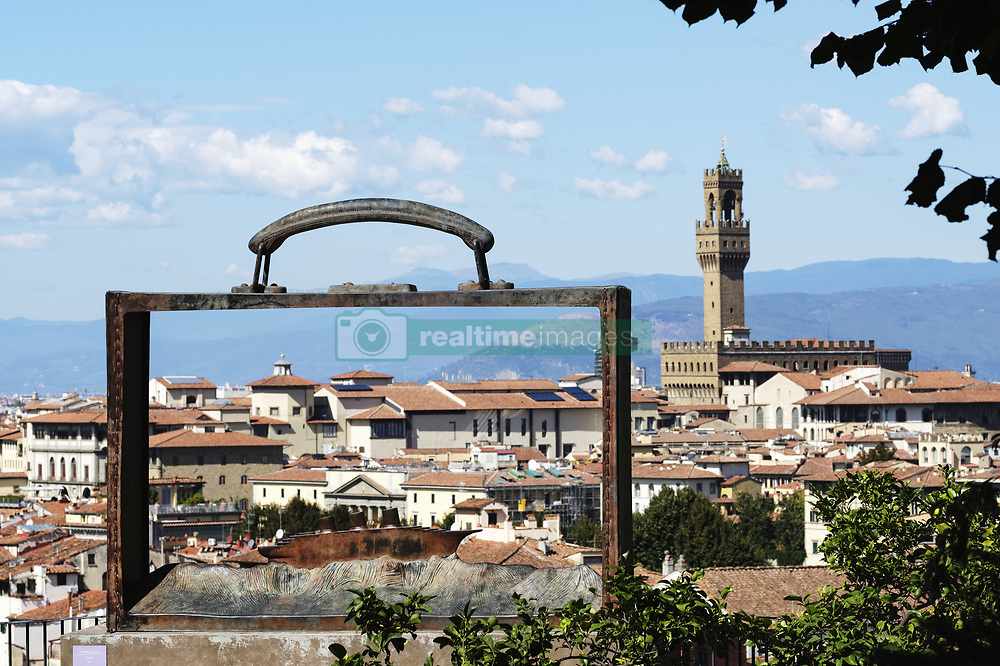 September 20, 2017 - Florence, Tuscany, Italy - Bronze suitcase, Partir by Jean Michel Foron in the Giardino delle Rose, with the Palazzo Vecchio in the background, below the Piazzale Michelangelo; Florence, Tuscany, Italy (Credit Image: © Michael Thornton/Design Pics via ZUMA Wire)