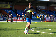 AFC Wimbledon defender Luke O'Neill (2) warming up prior to kick off during the EFL Sky Bet League 1 match between AFC Wimbledon and Peterborough United at the Cherry Red Records Stadium, Kingston, England on 18 January 2020.