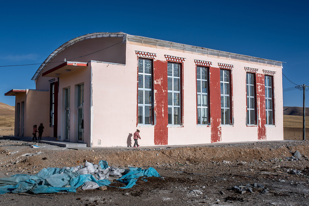 The gymnasium of the remote school settlement of Ngam-nak is the most modern building in the community. Ngam-nak serves as a school for Tibetan nomadic children, who are dropped off by their parents and spend 8 months a year in the remote settlement until they have completed a basic level of education. Staffed by a handful of teachers and cooks, there are no other activities in Ngam-nak apart from the school.