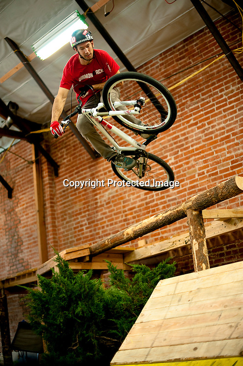 Eric Porter tables off of a log ride on the set of Fuel TV's Built To Shred