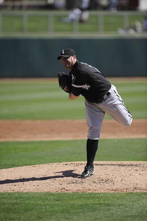 GLENDALE, AZ - FEBRUARY 28:  Will Ohman #77 of the Chicago White Sox pitches during the game against the Los Angeles Dodgers on February 28, 2011 at The Ballpark at Camelback Ranch in Glendale, Arizona. The Dodgers defeated the White Sox 6-5.  (Photo by Ron Vesely)
