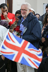 © Licensed to London News Pictures. 03/03/2019. London, UK. A child with Union Jack greets as Labour leader Jeremy Corbyn enters Finsbury Park Mosque in North London for the fourth Visit My Mosque Day.<br /> Over 250 mosques open their doors to non-Muslim guests and visitors on the fourth Visit My Mosque Day. This year the national event also encourages mosques to support Keep Britain Tidy's Great British Spring Clean campaign with many already taking part in cleaning their communities. Photo credit: Dinendra Haria/LNP