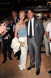 TAMARA BECKWITH and her husband GIORGIO VERONI at the Ralph Lauren Wimbledon Party held at Ralph Lauren, 1 New Bond Street, London on 17th June 2010.