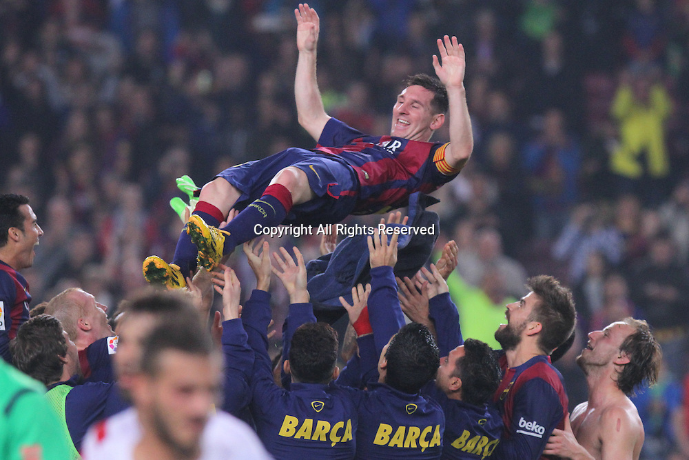 22.11.2014. Barcelona. Spain, La Liga football. Barcelona versus Sevilla. Leo Messi gets bumped after the  at Camp Nou.  Leo Messi  became the leading scorer in la Liga and beat Zarra's goals record