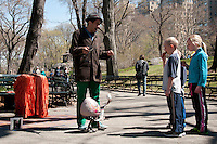 Street entertainer showing puppet to children in Central Park