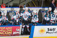 KELOWNA, CANADA - FEBRUARY 1: Cal Foote #25 speaks to Devante Stephens #21 of the Kelowna Rockets on the bench against the Calgary Hitmen on February 1, 2017 at Prospera Place in Kelowna, British Columbia, Canada.  (Photo by Marissa Baecker/Shoot the Breeze)  *** Local Caption ***