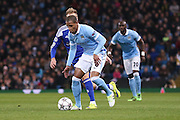 Manchester City midfielder Fernando (6)  during the Champions League Round of 16 match between Manchester City and Dynamo Kiev at the Etihad Stadium, Manchester, England on 15 March 2016. Photo by Simon Davies.