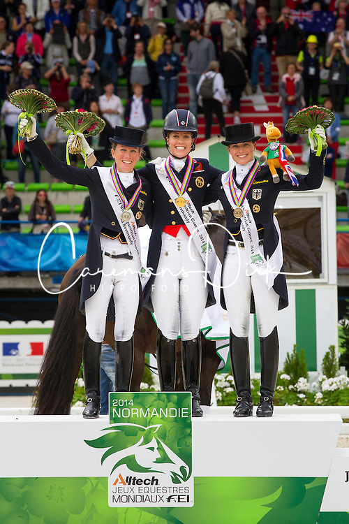 Podium Dressage Grand Prix Special 1. Charlotte Dujardin and Valegro, 2. Helen Langehanenberg and Damon Hill NRW, 3. Kristina Sprehe and Desperados - Grand Prix Special Dressage - Alltech FEI World Equestrian Games™ 2014 - Normandy, France.<br /> © Hippo Foto Team - Leanjo de Koster<br /> 25/06/14