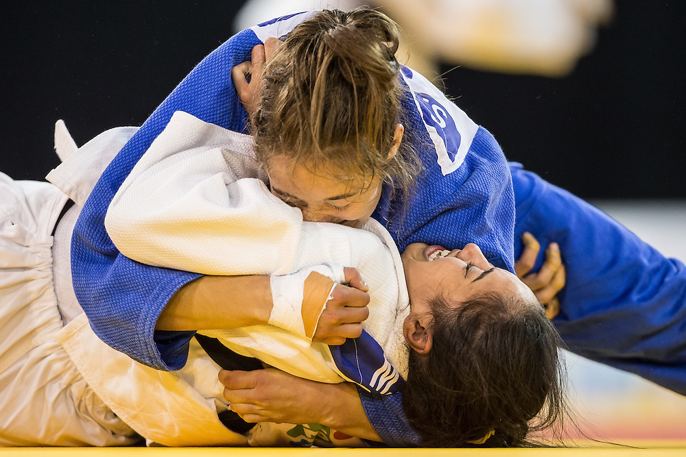 Stephanie Tremblay (Top) of Canada pins Mariana Silva of Brazil during their women's judo -63 kg final of the table at the 2015 Pan American Games in Toronto, Canada, July 13,  2015.  AFP PHOTO/GEOFF ROBINS