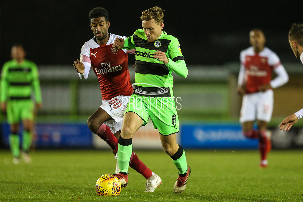 Forest Green Rovers Dayle Grubb(8) runs forward under pressure from Arsenal's Gedion Zelalem(60) during the EFL Trophy group stage match between Forest Green Rovers and U21 Arsenal at the New Lawn, Forest Green, United Kingdom on 7 November 2018.