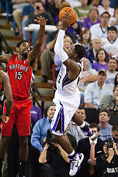 November 1, 2010; Sacramento, CA, USA;  Sacramento Kings point guard Tyreke Evans (13) shoots over Toronto Raptors power forward Amir Johnson (15) during the fourth quarter at the ARCO Arena. The Kings defeated the Raptors 111-108.