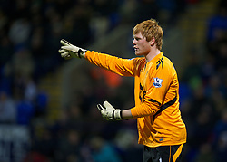BOLTON, ENGLAND - Saturday, January 21, 2011: Bolton Wanderers' goalkeeper Adam Bogdan in action against Liverpool during the Premiership match at the Reebok Stadium. (Pic by David Rawcliffe/Propaganda)