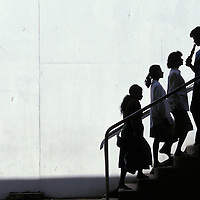 Sri Lanka, Worshippers at Buddhist shrine climb sunlit stairs.