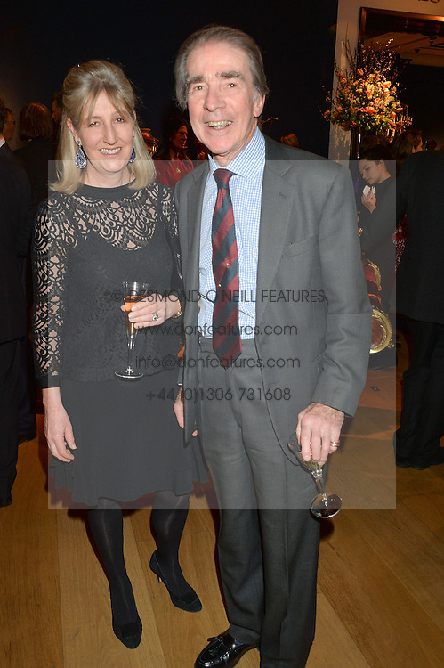 EARL & COUNTESS ALEXANDER OF TUNIS at a party to celebrate the publication of Interiors For Living by Joanna Wood held at Christie's. 8 King Street, St.James's, London on 2nd March 2015.