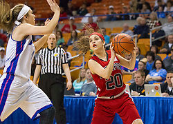 Bridgeport guard Gianina Renzelli (20) head fakes a defender against Fairmont Senior during a first round game at the Charleston Civic Center.
