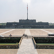 The citadel plaza at the Imperial City in Hue, Vietnam. A self-enclosed and fortified palace, the complex includes the Purple Forbidden City, which was the inner sanctum of the imperial household, as well as temples, courtyards, gardens, and other buildings. Much of the Imperial City was damaged or destroyed during the Vietnam War. It is now designated as a UNESCO World Heritage site.