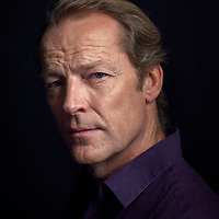 "Iain Glen is a Scottish film, television, and stage actor. Iain is best known for his roles in the Resident Evil films and for portraying Ser Jorah Mormont in Game of Thrones. Writing to Iain a few months ago to arrange a Portrait sitting for my 'Northerners' Exhibition. Iain accepted my invitation, and the session took place in London last month. Iain arrived on his Cycle at London Portrait Studio, Cycling being Iain's favorite pass time. After a chat about Iain's recent projects, I explained the style of images I wanted to achieve. ""I like to learn about each person I photograph, so I do my homework, this helps to start a conversation and put the sitter at ease.""<br />