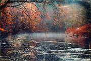 River landscape dressed in autumn colors. Texturized photo.<br />