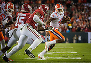 Clemson quarterback #4 Deshaun Watson runs 8 yards for a touchdown, during second quarter action of the national championship game at Raymond James stadium in Tampa.