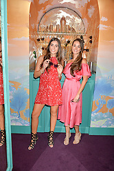 Left to right, sisters BEATRIZ CALLAGHAN and OLIVIA CALLAGHAN at a party for the UK launch of Mr Boho held at Annabel's, 44 Berkeley Square, London on 19th May 2016.