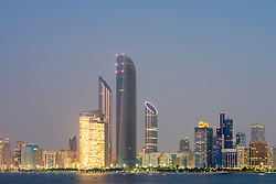 Evening view of modern skyline in Abu Dhabi in United Arab Emirates UAE