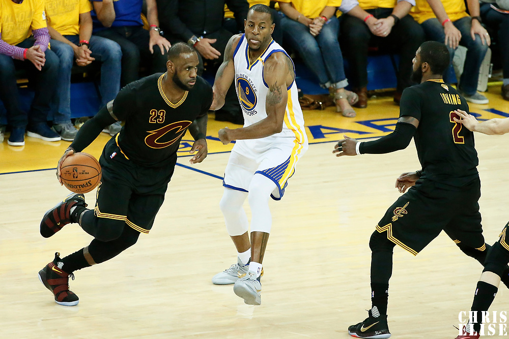12 June 2017: Cleveland Cavaliers forward LeBron James (23) drives past Golden State Warriors forward Andre Iguodala (9) on a screen set by Cleveland Cavaliers guard Kyrie Irving (2) during the Golden State Warriors 129-120 victory over the Cleveland Cavaliers, in game 5 of the 2017 NBA Finals, at the Oracle Arena, Oakland, California, USA.