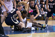 Miyah Sizer of Brighton and Lauren Graupman of Pittsford Sutherland fight for a loose ball during a game at Brighton High School on Thursday, January 21, 2016.