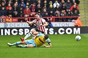 Rotherham United midfielder Will Vaulks (4) does sliding tacle on Sheffield United defender George Baldock (2)  during the EFL Sky Bet Championship match between Sheffield United and Rotherham United at Bramall Lane, Sheffield, England on 9 March 2019.