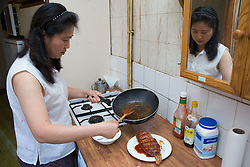 Woman preparing a Chinese meal for her family,