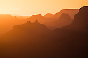 The many temples and buttes of the Grand Canyon are bathed in the warm light of the setting sun. From Desert View on the South Rim of Grand Canyon National Park in Arizona.