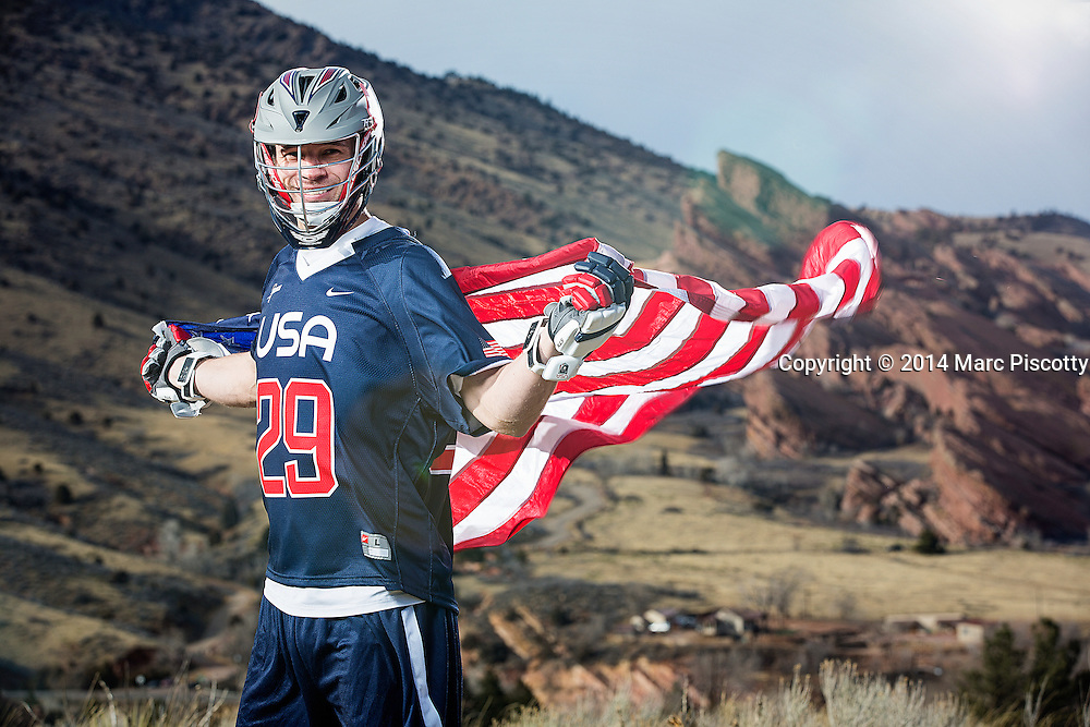 SHOT 2/22/14 4:18:28 PM - Denver Outlaws and Team USA defenseman Lee Zink poses for a portrait with Red Rocks and the foothills just outside of Denver, Co. in the background. Zink was named the 2012 Major League Lacrosse Defensive Player of the Year. When Zink grew up in Darien, Conn., and started his lacrosse career in sixth grade, he knew defense would be his calling card from the beginning. Zink will be playing in Denver this summer in the 2014 FIL World Lacrosse Championships.<br /> (Photo by Marc Piscotty / &copy; 2014)