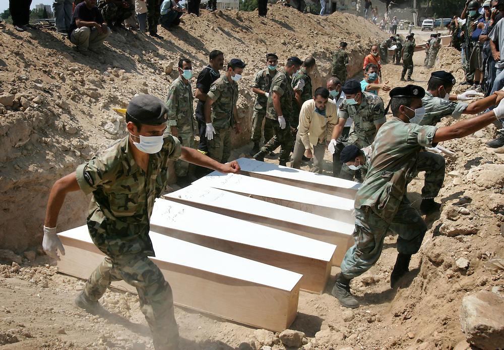 29th July 2006&#xD;&#xA;Tyre, Lebanon&#xD;&#xA;Mass Burial in Tyre&#xD;&#xA;On 29th July 2006 Lebanese medical and military personel prepared the bodies and coffins beofre burying more than 30 people killed by Israeli bombardment in a mass grave.<br />