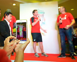 BANGKOK, THAILAND - Tuesday, July 14, 2015: A supporter takes a photograph of Liverpool ambassador Robbie Fowler during a signing session at the CentralWorld shopping mall in Bangkok on day two of the club's preseason tour. (Pic by David Rawcliffe/Propaganda)