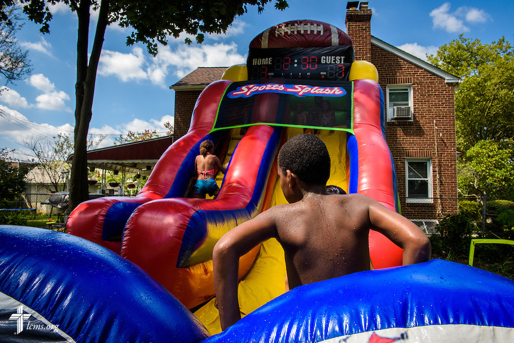 Children play in the water slide at the Mercy Medical Team on Friday, Aug. 26, 2016, at Shepherd of the City Lutheran Church in Philadelphia. LCMS Communications/Erik M. Lunsford