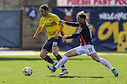 Luton Town's Danny Green attempts to tackle Oxford United's Danny Hylton during the Sky Bet League 2 match between Oxford United and Luton Town at the Kassam Stadium, Oxford, England on 16 April 2016. Photo by Shane Healey.