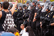 04/25/12-  Andy DeLisle.Phoenix police watch as protestors in the March for Justice against SB 1070 block the street outside the Phoenix I.C.E office on Wednesday April, 25 2012 in Phoenix, AZ.