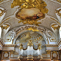 """Royal Chapel at Stockholm Palace in Stockholm, Sweden<br /> Since 1754, the Royal Chapel inside the Stockholm Palace has been the church for the Royal Family and their court yet anyone can attend the religious services.  Above the magnificent Gren-Stråhle organ are the Latin words which mean, """"Sing the Gods praise in this sanctuary.""""  The elaborate gilded ceiling has three paintings by Guillaume Taraval which show the ascension of Christ into heaven."""