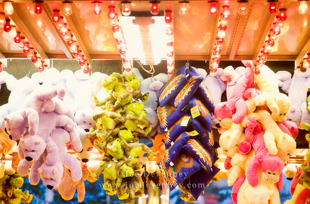 Stuffed animal prizes at a carnival game booth