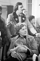 Woman listening at a rally in Goldthorpe Miner's Welfare during the 1984-85 miners strike. 4 December 1984<br />