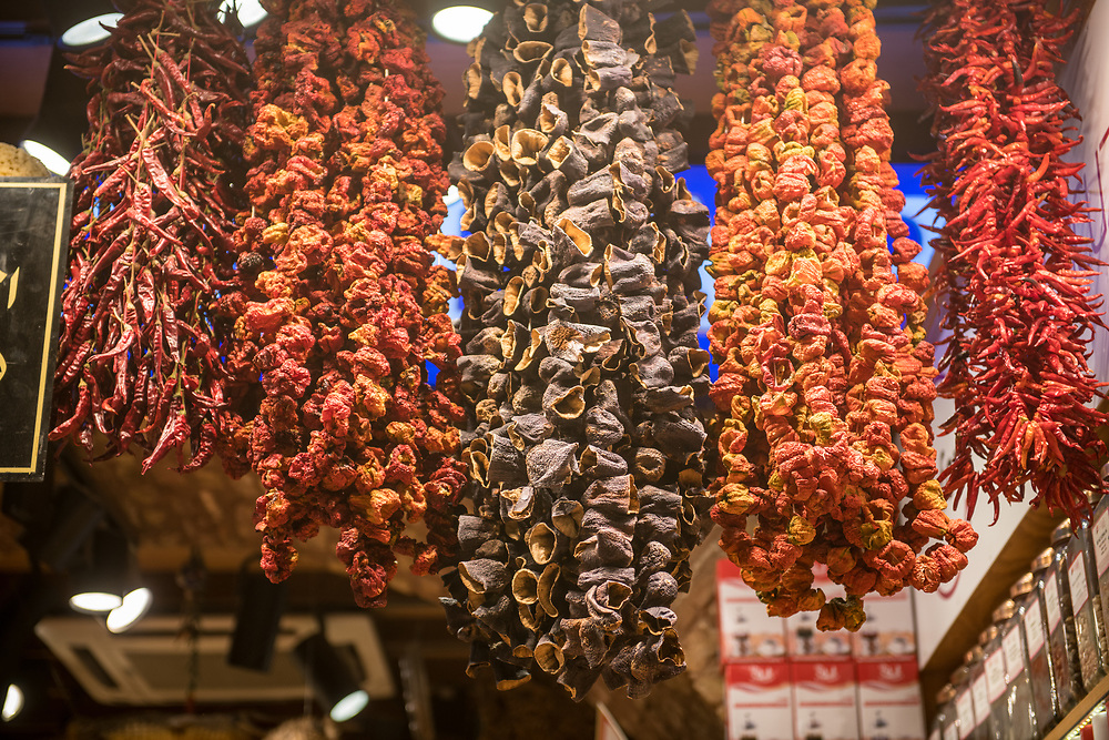 An array of dried spices hang in the entryway of storefront at Istanbul Spice bazaar in Turkey