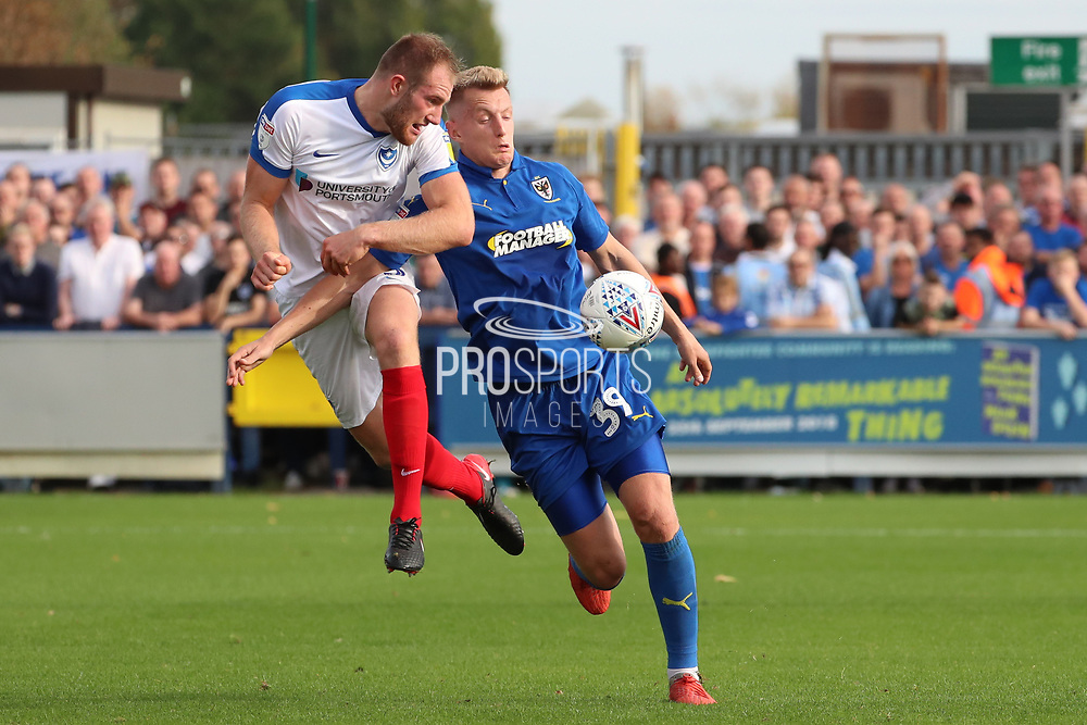 AFC Wimbledon striker Joe Pigott (39) battles for possession with Portsmouth defender Matt (Matthew) Clarke (5) during the EFL Sky Bet League 1 match between AFC Wimbledon and Portsmouth at the Cherry Red Records Stadium, Kingston, England on 13 October 2018.