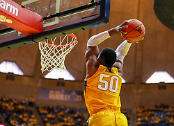Dec 8, 2018; Morgantown, WV, USA; West Virginia Mountaineers forward Sagaba Konate (50) dunks the ball during the second half against the Pittsburgh Panthers at WVU Coliseum. Mandatory Credit: Ben Queen-USA TODAY Sports