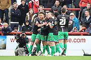 Bristol City striker, Lee Tomlin (9) celebrating scoring opening goal with team mates 0-1 during the Sky Bet Championship match between Brentford and Bristol City at Griffin Park, London, England on 16 April 2016. Photo by Matthew Redman.