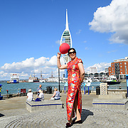 "The mainland Chinese singing together I Love My Country (我爱我的国家) The China-Britain Dress Art Festival and the celebration of Great China 70th Anniversary 2019. A ""Qipao"" Flash Torch relay began at Portsmouth. The mainland Chinese in 28 counties and cities across Britain will participate in the thousands of cheongsams and end in London on the 28 September 2019, UK."