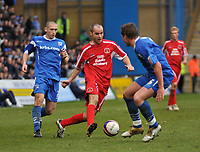 Photo: Tony Oudot/Richard Lane Photography. <br /> Gillingham Town v Carlisle United. Coca-Cola League One. 21/03/2008. <br /> David Raven of Carlisle takes on the Gillingham defence of Andrew Crofts and Simon King