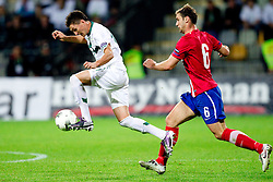 Andraz Kirm of Slovenia vs  Branislav Ivanovic of Serbia during football match between National Teams of Slovenia and Serbia of UEFA Euro 2012 Qualifying Round in Group C on October 11, 2011, in Stadium Ljudski vrt, Maribor, Slovenia.  Slovenia defeated Serbia 1-0. (Photo by Vid Ponikvar / Sportida)