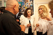 STEVEN BERKOFF; JOAN COLLINS; BASIA BRIGGS, Drinks party hosted by Basia Briggs. Sloane Gdns. London. 24 May 2010. -DO NOT ARCHIVE-© Copyright Photograph by Dafydd Jones. 248 Clapham Rd. London SW9 0PZ. Tel 0207 820 0771. www.dafjones.com.