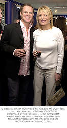 TV presenter GABBY ROSLIN and her husband MR COLIN PEEL, at a party in London on 1st May 2002.OZN 38