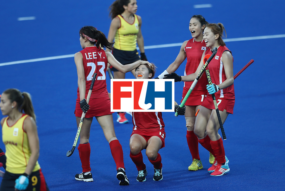 RIO DE JANEIRO, BRAZIL - AUGUST 13:  Eunbi Cheon of Korea celebrates with team mates after scoring the opening goal during the Women's group A hockey match between the Republic of Korea and Spain on Day 8 of the Rio 2016 Olympic Games at the Olympic Hockey Centre on August 13, 2016 in Rio de Janeiro, Brazil.  (Photo by David Rogers/Getty Images)